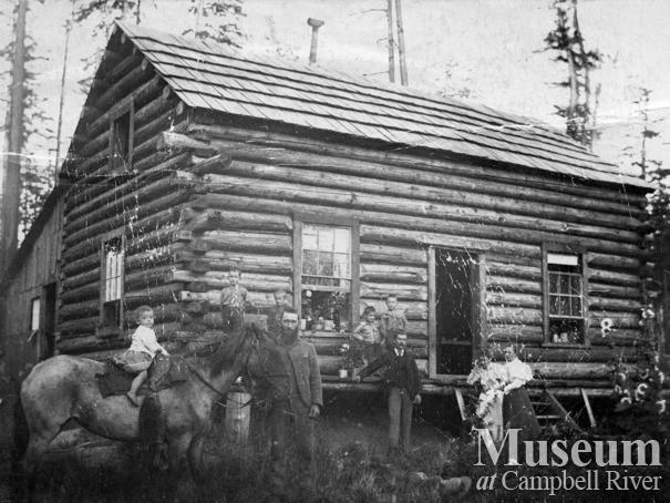 The Yeatmans in front of their log cabin at Sunnyside Farm, Quadra Island