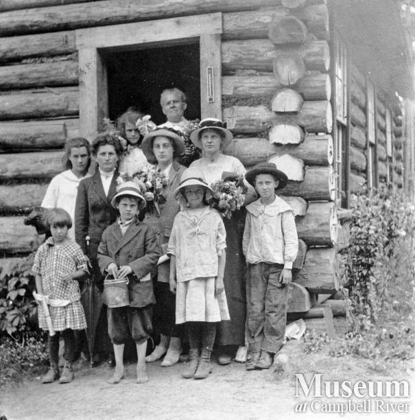 School teacher with pupils at Mansons Landing, Cortes Island