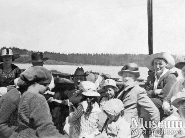 Group of early Quadra Island residents on board a boat in Quathiaski Cove