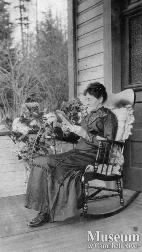 Emma Yeatman on front porch of her Quadra Island home