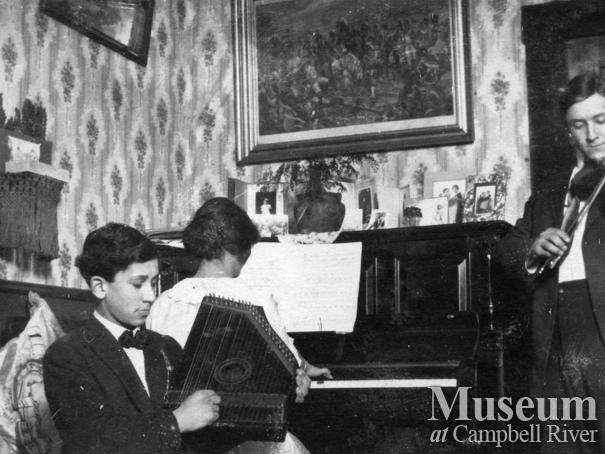 The Yeatman family playing musical instruments in their home