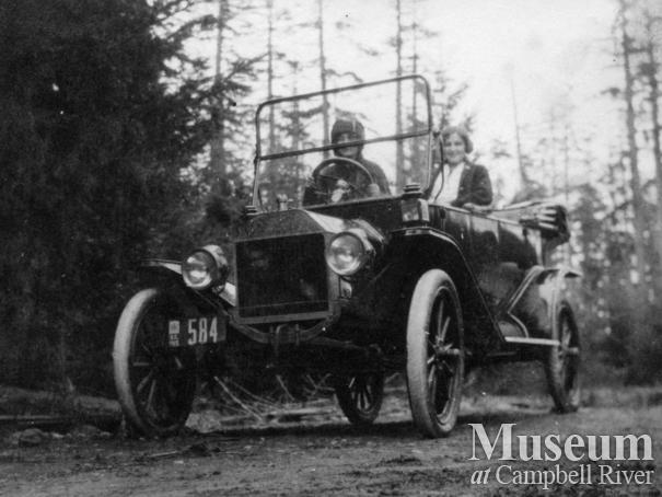 Two young ladies in a car at Sunny Side Farm, Quadra Island