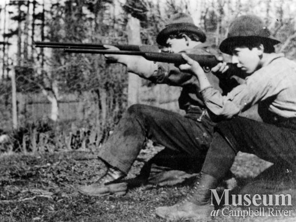 Yeatman brothers with their rifles at Sunny Side Farm, Quadra Island