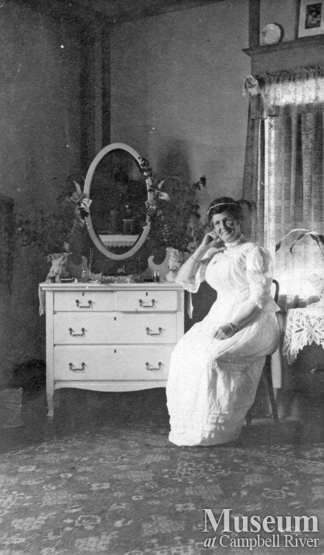 Mrs. James A. Nixon in her bedroom at Twin Islands