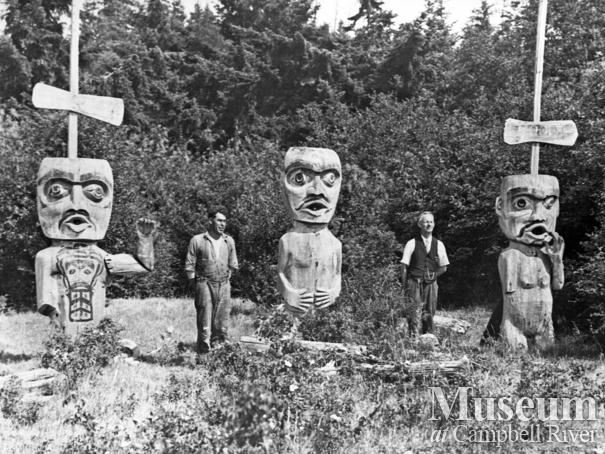 Three carved welcome figures at Cape Mudge, Quadra Island