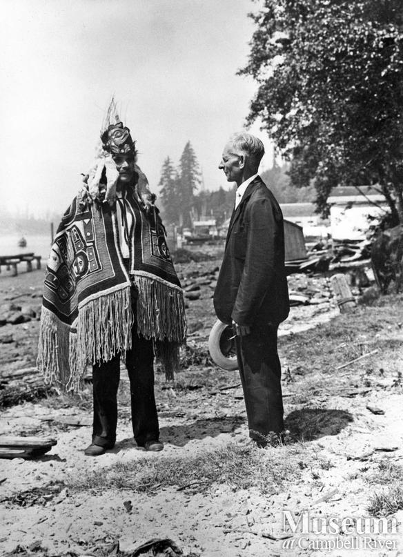 Chief Billy Assu with a missionary on the beach at Cape Mudge Village, Quadra Island