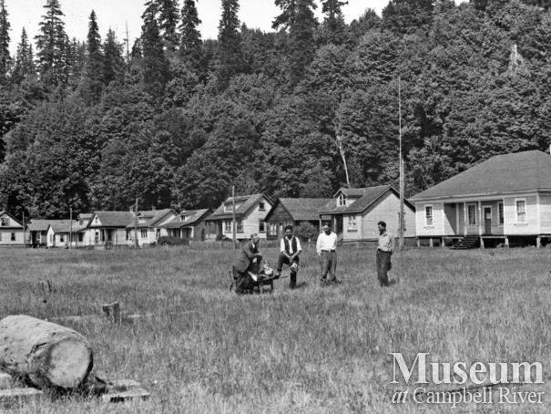 Group in front of the houses at Cape Mudge Village, Quadra Island