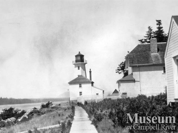 View of the buildings and lighthouse at Cape Mudge, Quadra Island
