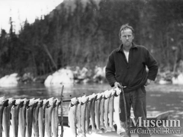 August Schnarr with catch of  trout from Homathko or Southgate River