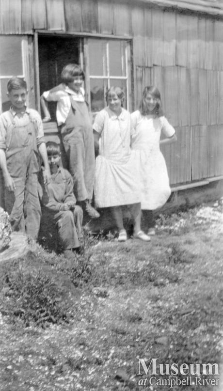 Teacher Doris Nye with pupils at the schoolhouse on Read Island