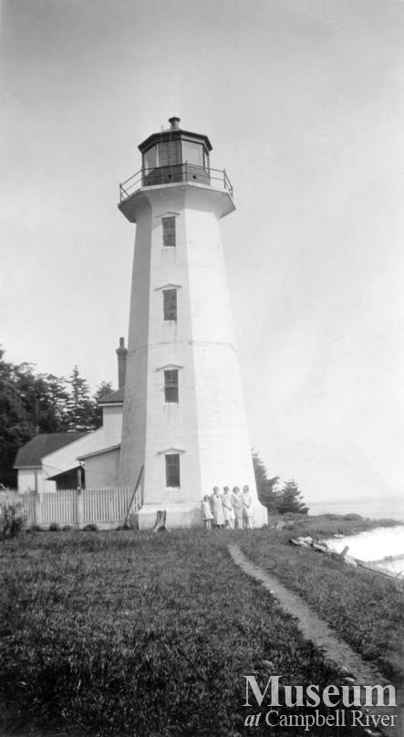 Group standing beside the Lighthouse at Cape Mudge, Quadra Island