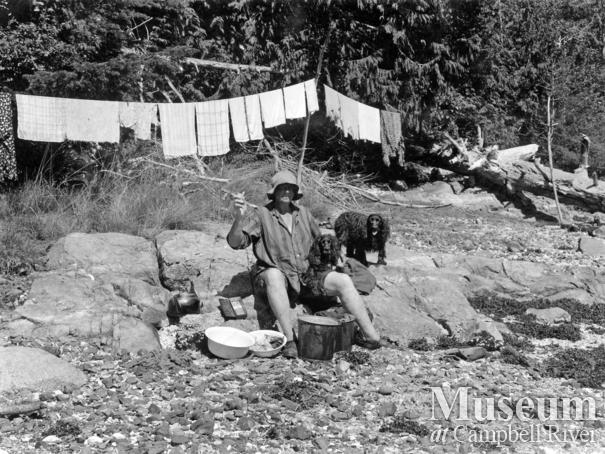 Amy Barrow doing laundry on the beach at Klaoitsis Island
