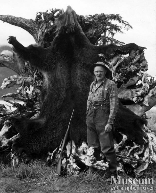Guide Jim Stanton, with grizzly bear hide in the Knight Inlet area