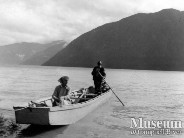 "The Stantons in their ""Family Car"" at the head of Knight Inlet, B.C."