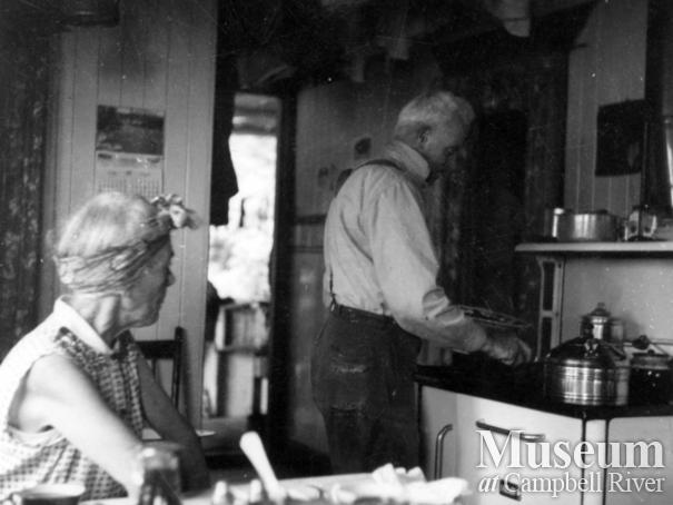 Jim Staton cooking pancakes for breakfast in their kitchen