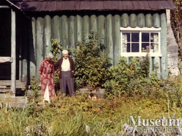 Jim and Laurette Stanton in front of their home, Knight Inlet, B.C.