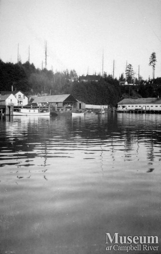 View of Quathiaski Cove  showing the sawmill (on left) and Cannery (on right)