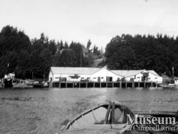 View of Quathiaski Cove, Quadra Island showing several of the cannery buildings.