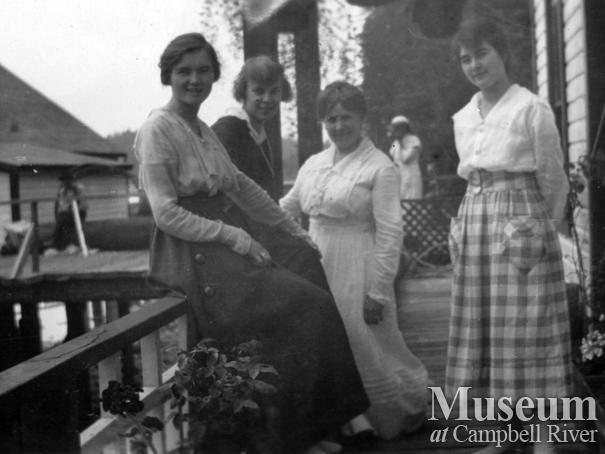 Group on the porch of the Anderson home, Quathiaski Cove, Quadra Island