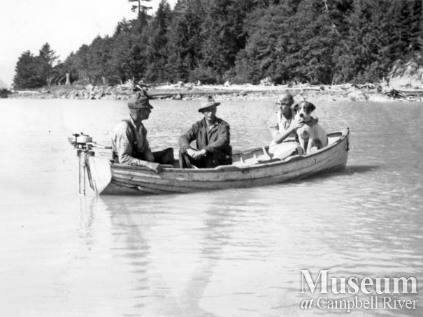 Group in wooden boat at the head of Knight Inlet