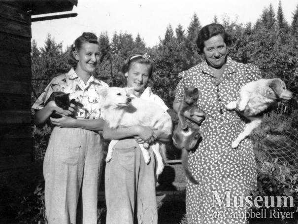 Gerrad family members with their pets, Heriot Bay