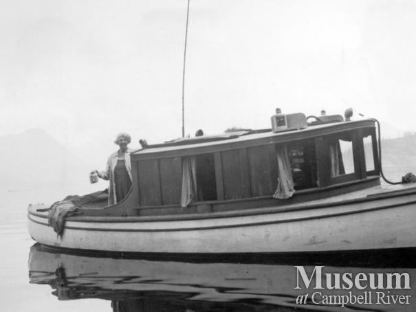 "Amy Barrow on the deck of their boat M.V. ""Toketie"""