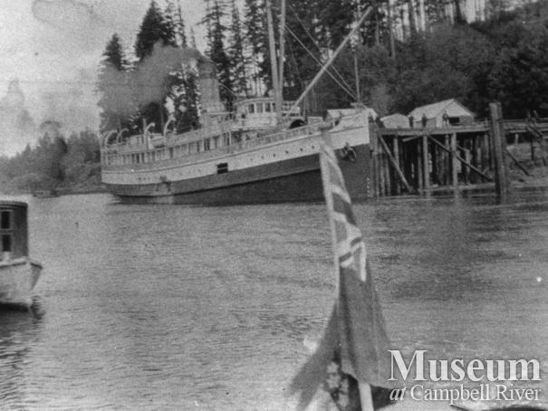 "Union Steamship Co. boat the ""Cheakamus"" docked at wharf in Quathiaski Cove"