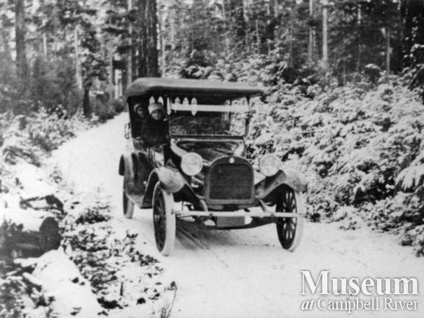Anderson family car on road in the winter, Quathiaski Cove, Quadra Island