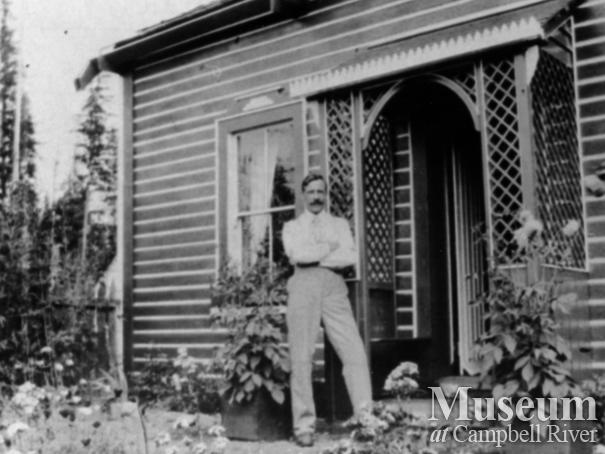 Gentleman in front garden of J. Hovell's home, Quadra Island