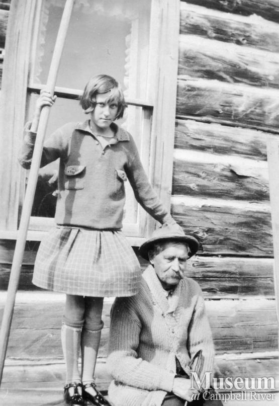 Hans Hansen with daughter, Edith  in front of their home at Port Neville, B.C.