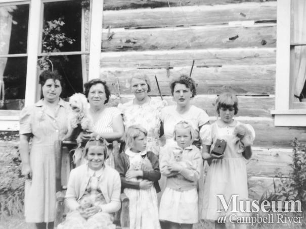 Members of the Hansen family in front of their home at Port Neville