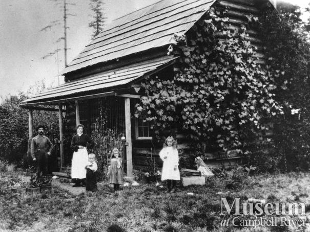 The Wilson family in front of their home on Quadra Island