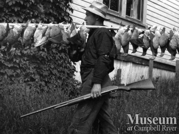 Rob Yeatman with dead pidgeons, Quadra Island