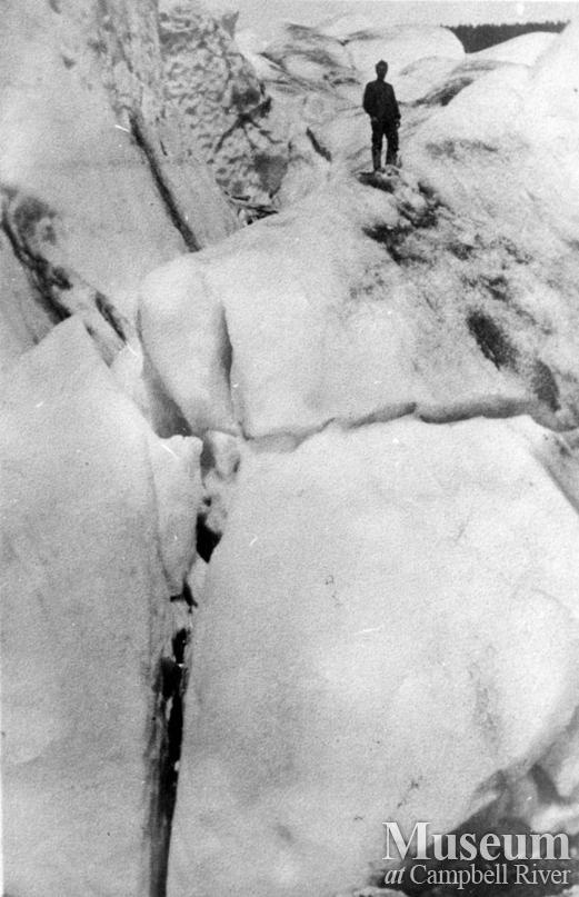 August Schnarr standing on Kleena Kleene glacier