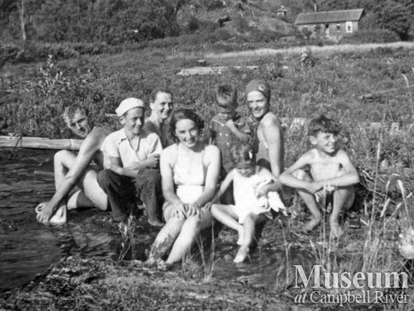 Cortes Island residents on beach in front of the McKay house, Gunflint Lake
