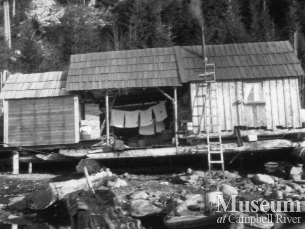 August Schnarr's float house on beach either at Phillips or Frederick's Arm