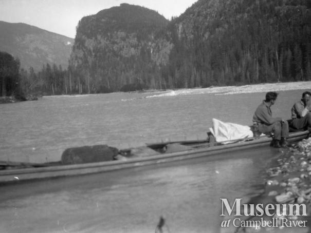 MacDonald and Hill in one of August Schnarr's river boats