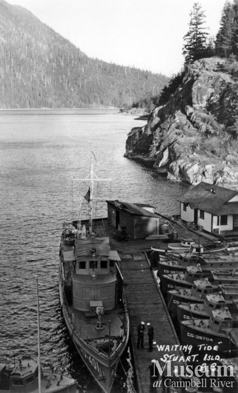 Navy boats tied up at dock at Stuart Island