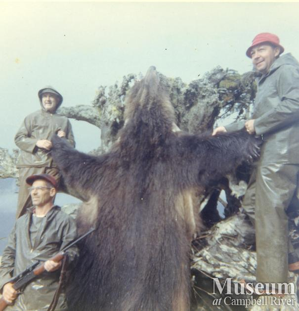 Hunters in Knight Inlet area with grizzly hide