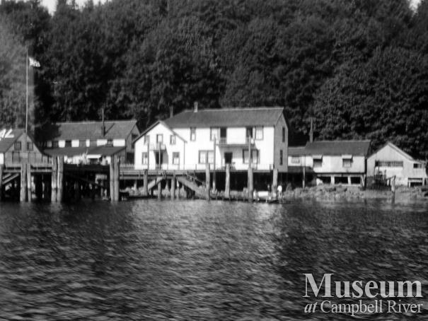 View of buildings at Quathiaski Cove, Quadra Island sometime after 1910