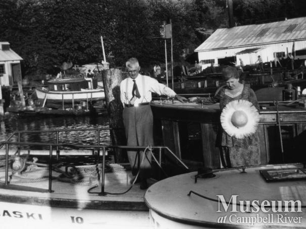 """W.E. Anderson and his wife Margaret on board the """"Quathiaski 10"""""""