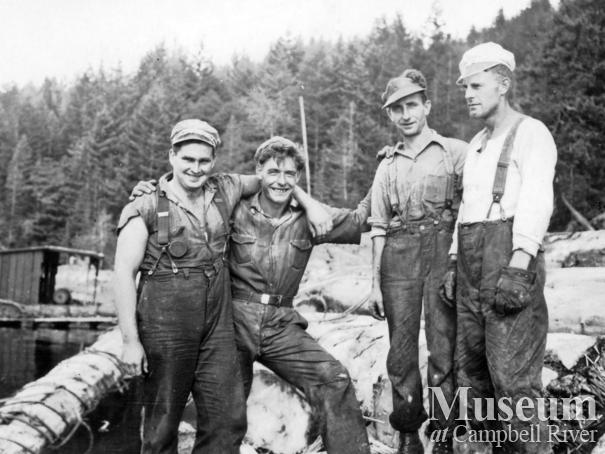 Four loggers at Powell River Company boom at Teakerne Arm