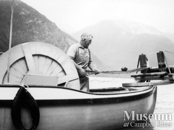 Angus Kerr hauling in his gillnet while fishing in Toba Inlet