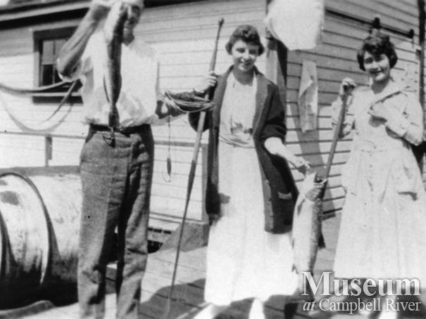 Mae Anderson with catch of salmon at Quathiaski Cove