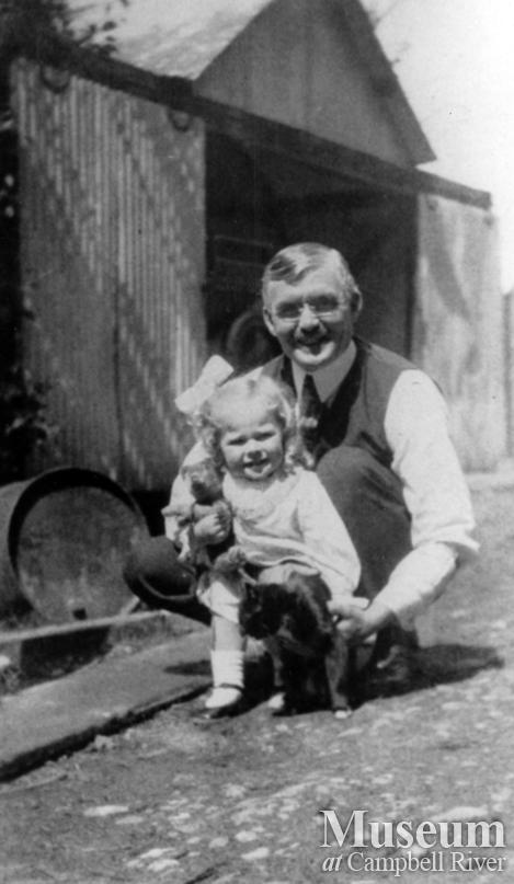 W.E. Anderson with a little girl (Irene Whipple) and cat