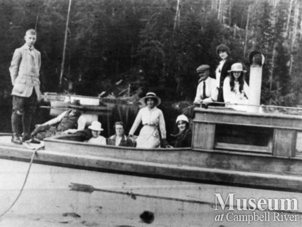Members of the Anderson family on their boat the Quathiaski No. 10