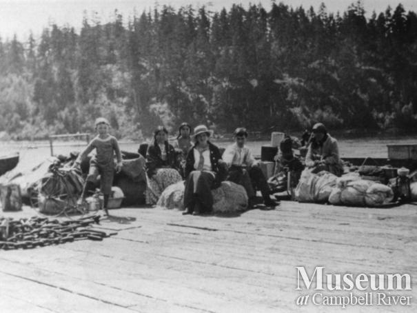 Quadra Island residents waiting for a boat at the wharf at Quathiaski Cove
