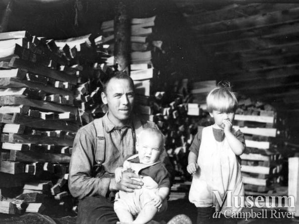 August Schnarr with two of his children